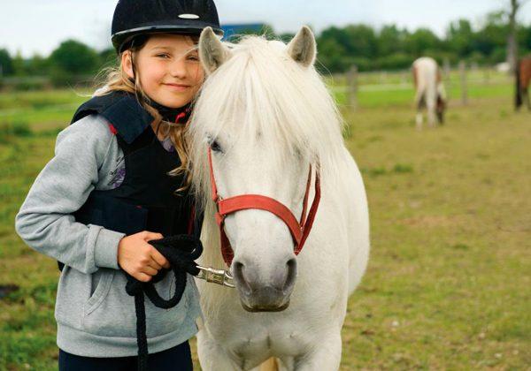 Montar a caballo en Coslada para niños